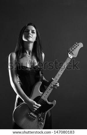 Young girl plays guitar naked