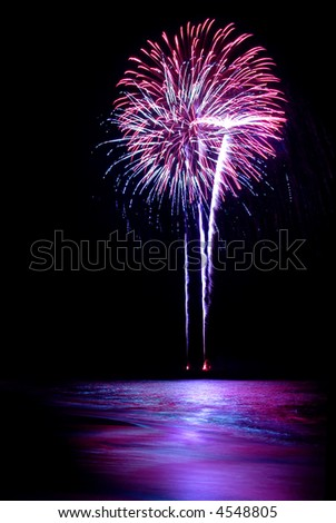 Photo of a fireworks at the beach.