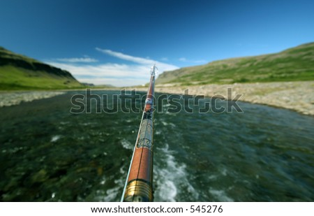 Photo of a fishing rod seen from the anglers view. Short DOF.