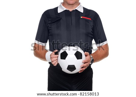 Photo of a football or soccer referee holding a ball and whistle, red and yellow cards in his pocket, isolated on a white background.