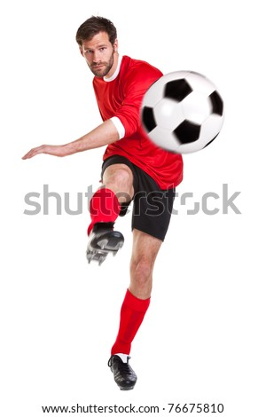Photo of a footballer or soccer player cut out on a white background,.