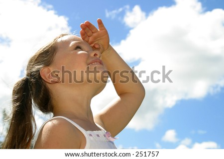 Photo of a girl looking up into the sky.