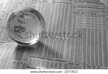 Photo of a Glass Globe on a FInancial Newspaper - Black and White