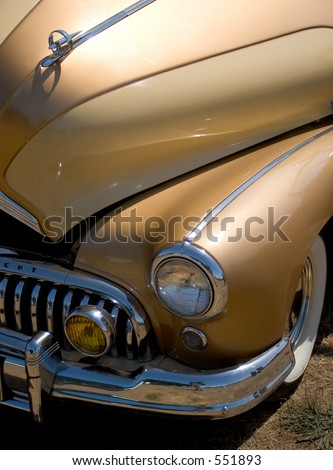 Photo of a golden car from the 50's #551893