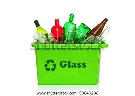 Photo of a green glass recycling bin isolated on a white background.