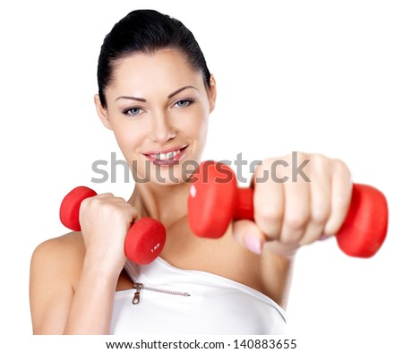 Photo of a healthy training young woman with dumbbells.  Healthy lifestyle concept.