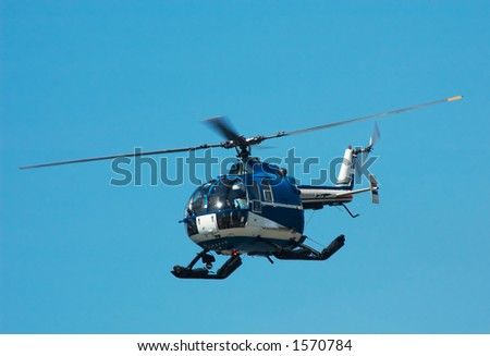 Photo of a helicopter against a blue sky