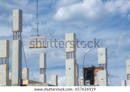 Photo of a house under construction. Building under construction. Lifting cranes and building under construction. big construction site.  #657626929