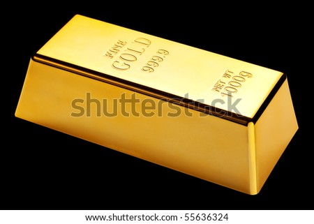 Photo of a 1kg gold bar isolated on a black background
