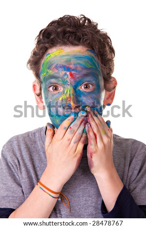 Photo of a kid having fun with painted face. Isolated on white background.