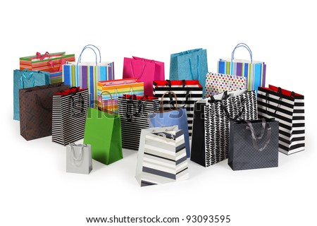 Photo of a large group of colourful shopping bags. Clipping path included. Shadows visible.