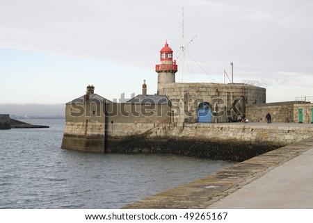 photo of a lighthouse on the  Ireland coast