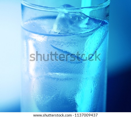 Photo of a macro glass with ice and cold water