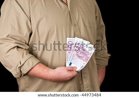 photo of a male person with 500 euro in cash on black