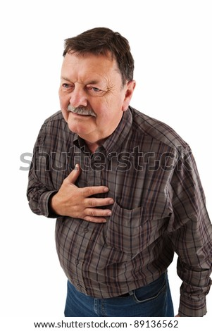Photo of a man in his sixties having a dose of heartburn or pains in his chest.