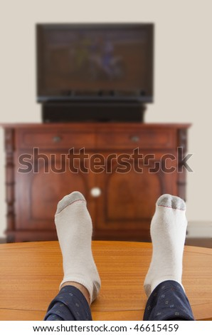 photo of a man watching TV