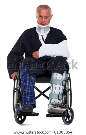 Photo of a mature male with various injuries in a wheelchair, he's wearing a neck brace, arm sling and leg cast and has a black eye, isolated on a white background.