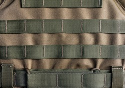 Photo of a military armor vest molle system closeup view.