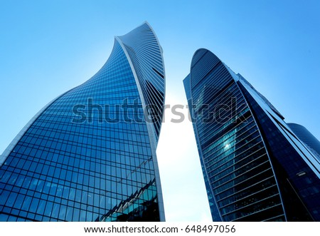 Photo of a modern bright tower of a skyscraper on a sunny afternoon #648497056