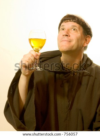 Photo of a monk looking enjoying a good glass of wine.