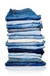 Photo of a pile of old worn blue and white jeans