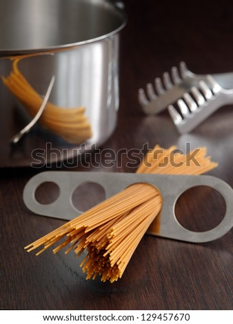 Photo of a portion of spaghetti measured and about to put into a pot for cooking.