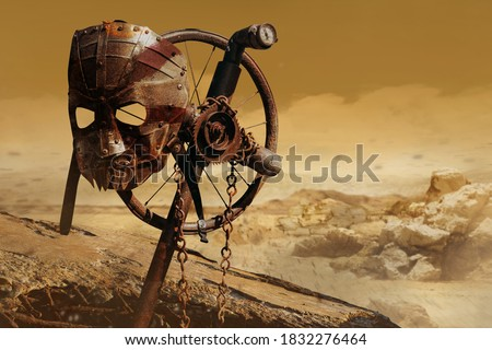 Photo of a post apocalyptic raider warrior metal armor mask hanging on cross sign on desert wasteland background.