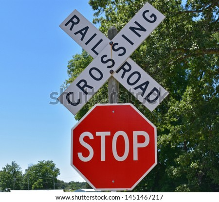 Photo of a railroad crossing sign with a stop sign