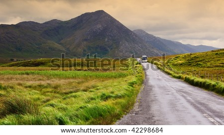 photo of a scenic irish nature landscape with tourist bus