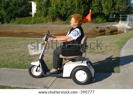 Photo of a senior woman on a buggy.