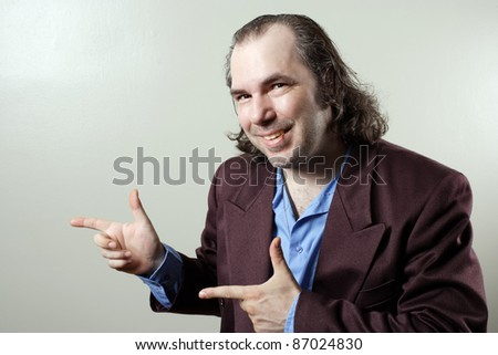 Photo of a sleazy salesman pointing at something.