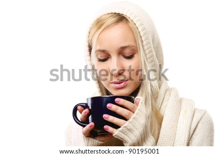 Photo of a smiling female holding a cup of coffee, hot chocolate, or tea isolated on white background