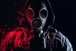 Photo of a stalker face in soviet old gas mask with filter and red highlights dissolving on black background.