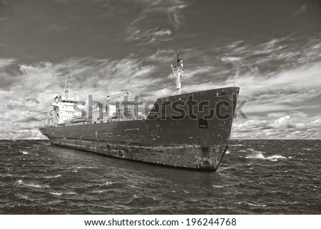 Photo of a tanker ship on sea in black and white tone.