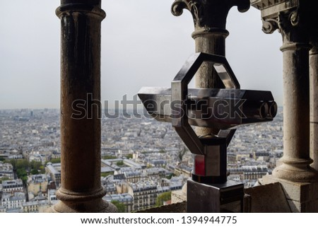Photo of a telescope lookout point on top of the Sacre Coeur Cathedral in Paris, France.