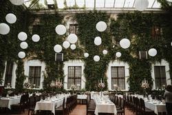 photo of a wedding location with dinner tables