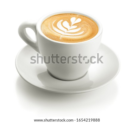 Photo of a white cup of cappuccino froth isolated on a white background