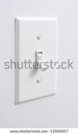 Photo of a white light switch - stock photo