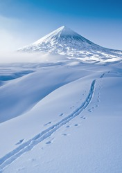 Photo of a winter trip to Klyuchevskaya Sopka. Klyuchevskaya Sopka is an active volcano of the Kamchatka Peninsula, the highest point in Eurasia.
