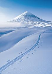 Photo of a winter trip to Klyuchevskaya Sopka. Klyuchevskaya Sopka is an active volcano of the Kamchatka Peninsula, the highest point in Eurasia.