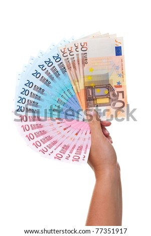 Photo of a womans hand holding a fan of Euro banknotes, isolated on a white background.