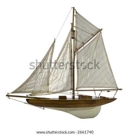 Photo of a wood replica of a sailing boat isolated on white background.