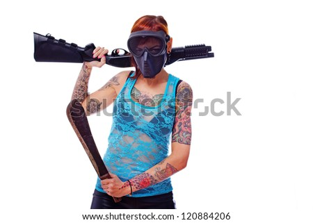 Photo of a young punk girl armed to the teeth