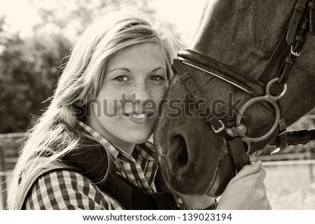 Photo of a young woman who loves her horse - black and white