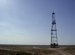 Photo of abandoned oil rig in steppe of Middle Asia