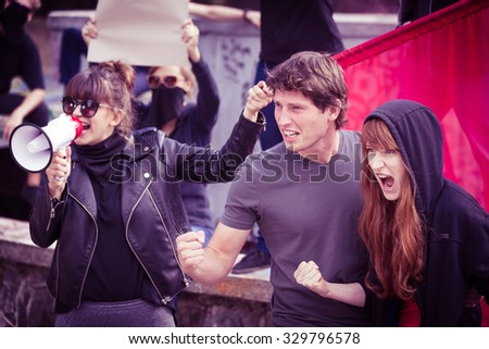 Photo of active young participants of street demonstration