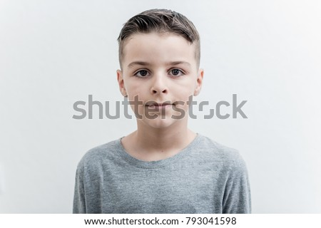 Photo of adorable young happy boy looking at camera.Isolated on the white background
