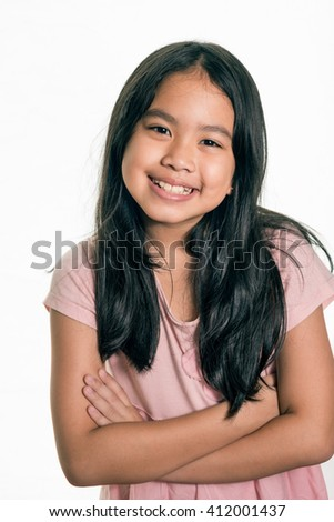 Photo of adorable young happy girl ,dreadlocks hair style, looking at camera. ,Isolated  - Shutterstock ID 412001437