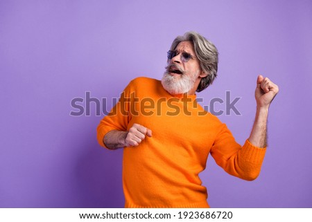 Photo of aged man happy positive smile have fun enjoy music dance isolated over violet color background Stockfoto ©