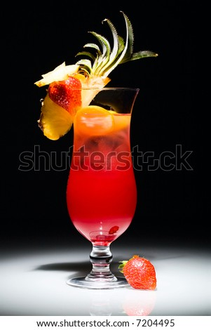 Photo of alcoholic cocktail with strawberry and piece of pineapple